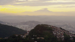 Still shot of the hills beneath a yellow sunset in Rio de Janeiro Stock Footage