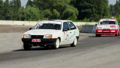 Car racing teams recklessly competing on track for championship, click for HD - stock footage