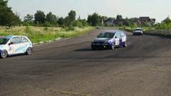 Reckless pursuit on race track for leading position, sharp turn, click for HD Stock Footage