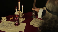 Chronicler writes in the candlelight Stock Footage