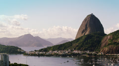 Static, high definition, shot of an airplane flying over Guanabara Bay - Rio de Stock Footage