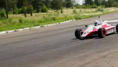 F1 driver turns sharply, moving fast towards finish, leads race, click for HD Stock Footage