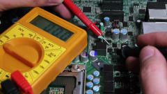 Multimeter testing electronic board charges. Stock Footage