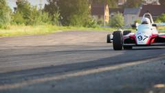 Formula one race cars fallowing each other, taking turn, click for HD - stock footage