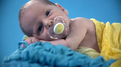 Little baby chewing the pacifier Stock Footage