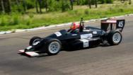 Stock Video Footage of Formula one driver taking sharp turn at the race track, click for HD