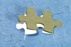 Fitting the last piece of puzzle Stock Photos