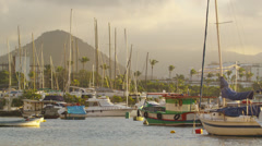 Pan of picturesque fishing boats in a Rio harbor. Stock Footage