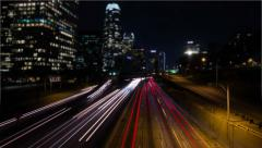 4k Tilt Shift Time Lapse Busy Freeway Downtown At Night - stock footage