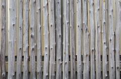Old fence poles. abstract background Stock Photos
