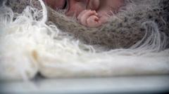 Tilt shot of baby in woollen cover Stock Footage
