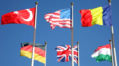 National flags of various countries  against a blue sky Stock Footage