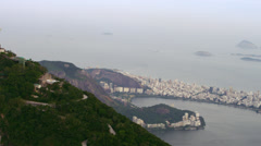 Aerial view of famous and reverent Corcovado mountina with back of Christ Stock Footage