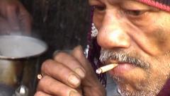 Close shot of old Indian man smoking biri. Stock Footage