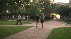 Group of students walking various directions Stock Footage