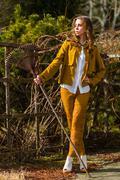 woman and rake - stock photo