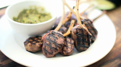 Deliciously Juicy Grilled Lamb Cutlests And Basil Pesto Dip. Stock Footage