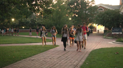 Group of students walking and texting Stock Footage