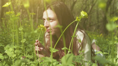 Pretty Woman Smelling Flower Forest Nature Health Concept HD Stock Footage