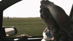 Pretty Female Joy Car Ride Music Dancing Wind Hair Freedom HD Stock Footage