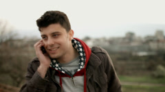 Young Man Smiling Talking on Cellphone HD Stock Footage