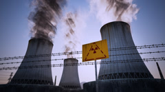 Nuclear power plant cooling towers. Radioactive sign.Sunset - stock footage