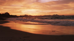 Slow motion, tracking shot of huge waves crashing on Devil's beach (Praia do Stock Footage