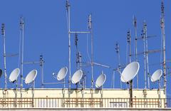 Tv antennas and satellite dishes to receive television and radio programs Stock Photos