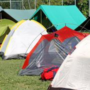 tents in a soccer field - stock photo