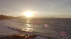 Waves roll onto Ipanema Beach during sunset in Rio de Janeiro. Stock Footage