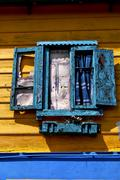 venetian blind and a yellow wall  la boca buenos aires argentina - stock photo