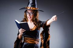Witch in scary halloween concept - stock photo