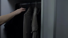 Stock Video Footage of Picking up the right wardrobe