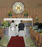 Church during the rite of marriage with a yellow rose and the bride Stock Photos