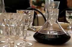 Decanter with wine in a table with glass Stock Photos