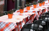 Stock Photo of tables laid with checkered tablecloth for a stylish restaurant