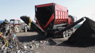 Stock Video Footage of Compost production at recycling plant. Strainer  drum used for cleaning compost.