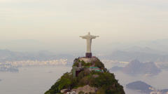Tracking footage of Rio's Christ Redentor and bay Stock Footage