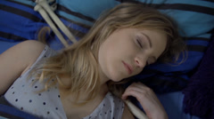 Woman sleeps tightly with skeleton laying next to her Stock Footage