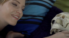 Woman is really happy to be with skeleton in the same bed Stock Footage