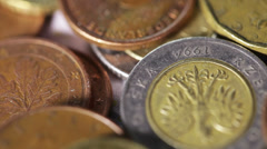 Coins EU on rotating surface on burlap background Stock Footage