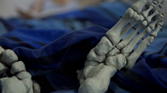Skeleton feet in the bed Stock Footage