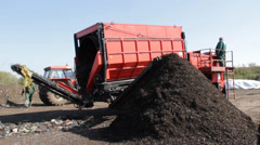 Compost production at recycling plant. Strainer  drum used for cleaning compost. Stock Footage