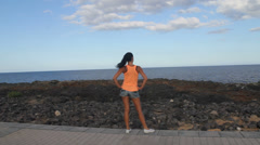 slim fitness girl looking at the ocean - stock footage