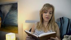 Girlfriend reads to her boyfriend Stock Footage
