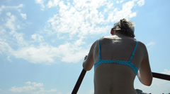 Girl rowing hard trying to turn the boat Stock Footage