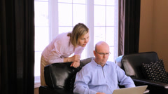 Middle Aged Man And Woman With Laptop Stock Footage