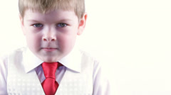 Severe young businessman with a red tie, a look at the camera Stock Footage