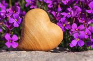 Stock Photo of Wooden heart with flowers