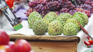 Stock Video Footage of Slow motion shot of sugar apples and other fruits at a market in Rio de Janeiro,
